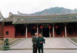Master Tham (when he was young) with his master studying the wonderful Feng Shui at a well known temple in China.