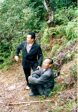 Grand Master Tham and his Master take a rest while leading him up to the jungle to studies the various types of dragon mounds, its good and bad earth, sheltering of types of wind and its water accumulation, as well as various side elements.